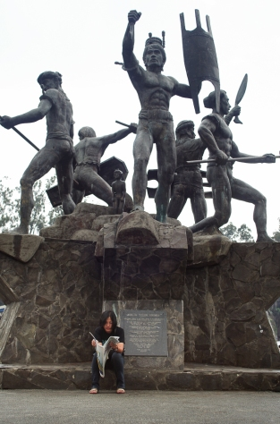 Local newspaper reader just beside the monument at Igorot Park in Baguio City.